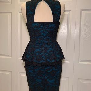 Black lace over blue peplum dress